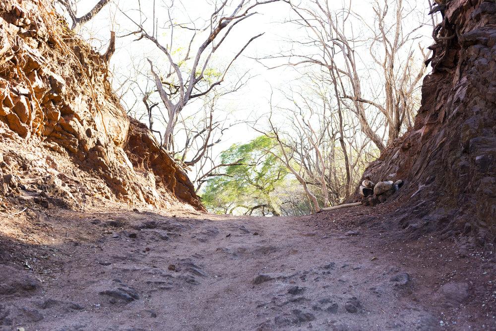 A rocky path dividing the beach at Playa Conchal.