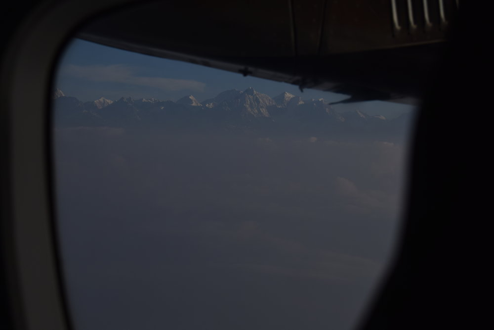 I pressed against the window as we took off. It's pretty crazy to think that your plane is actually flying lower than some of the mountains. Coming into Kathmandu, we could also see some of the mountains from far away on our jetliner but this time we were a lot closer.