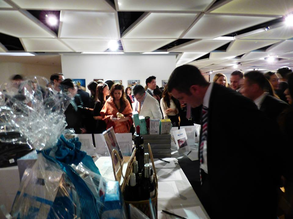 Guests at the Silent Auction display