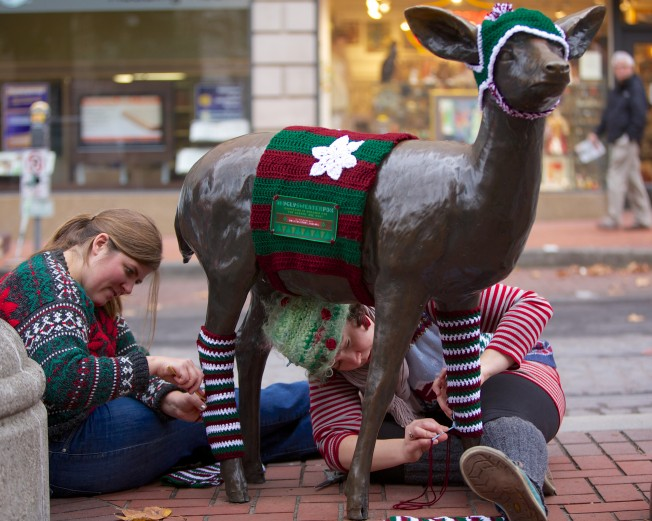 Jessica and Jenny dress up downtown's deer. [Photo by: Travel Portland]