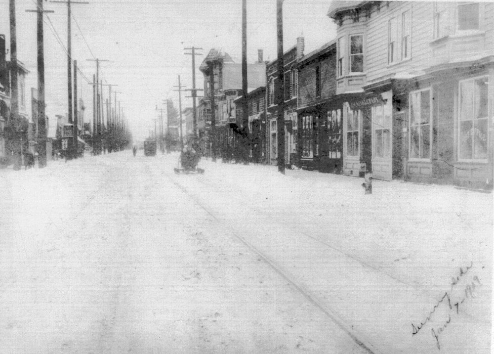 The oldest known photo of the Belmont business district, taken at SE 33rd & Belmont looking east during a snow storm on January 7th 1909. Photo: Oregon Historical Society