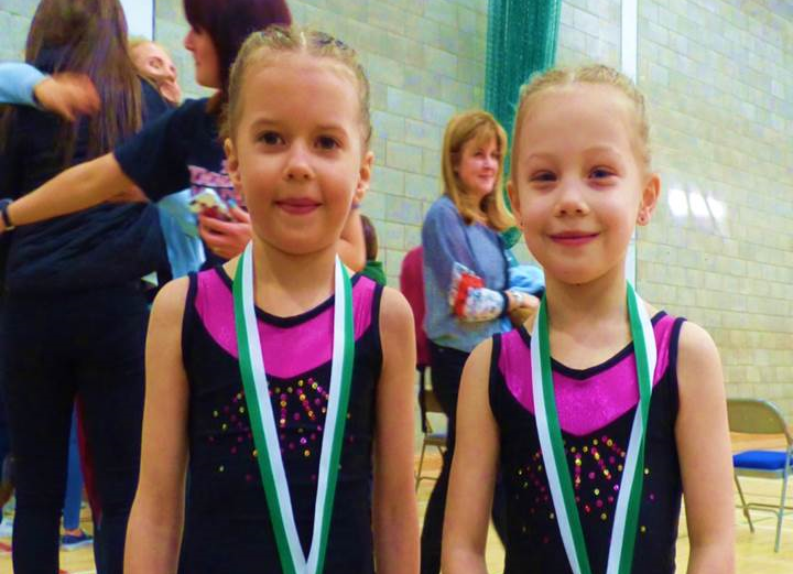 Well done to Class 1 girls who recently came first in their class in their first ever NI Schools   Gymnastics   Competition.    Emily McNickle and Siobhan Mercelot came joint first in the under 11's novice class, having only started classes at Queen's   Gymnastics   Club with Jane Devenny  less than two months ago.    The seven-year-old girls impressed the judging panel with a routine choreographed by their coach Jane which included cart wheels, hand stands, bridges, kick- overs and tumbles, set to the tune of Paddington Bear and were all smiles with the loud round of applause at the end.    Their smiles were even bigger when, after leading out the competitors in a march around the mat, the head judge said they had come joint first and handed them their gold medals, both of which now have pride of place in their bedrooms.