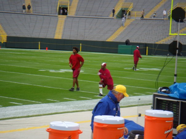 ( L to R:) Safety Sean Taylor stretching with teammate LB Rocky McIntosh before a game in Green Bay, WI