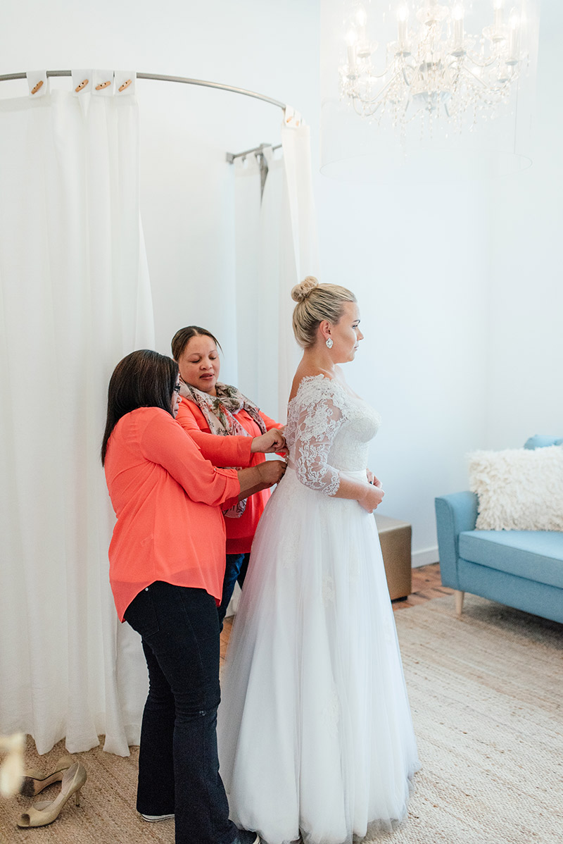 Mellissa and Philzain dressing our bride Marine during a final fitting. Photo: Debbie Lourens