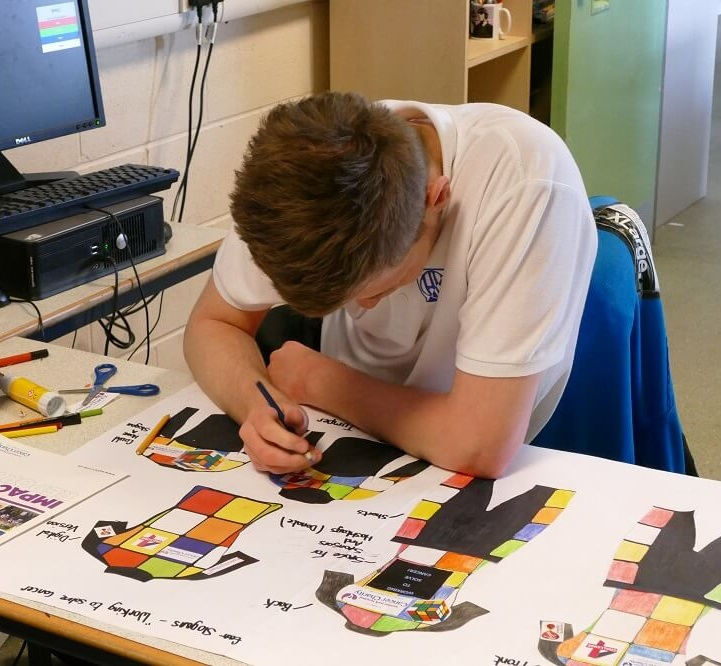 Lewis works on his design at Hinde House School