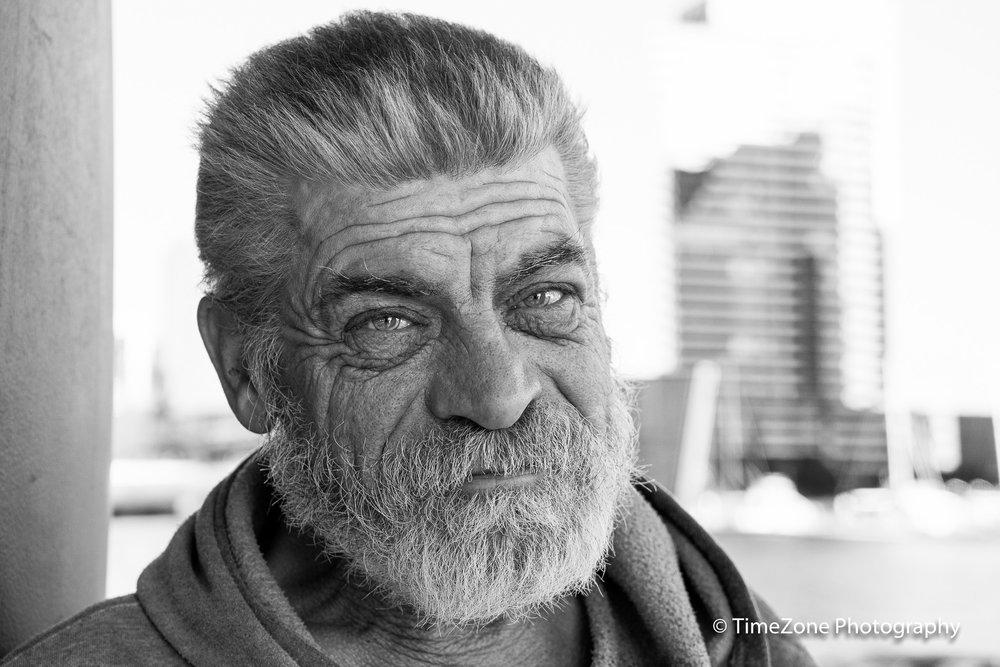 His face shows a map of a tough life.