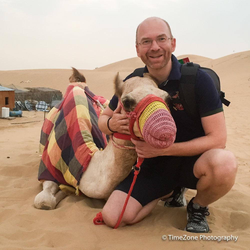 Me and a young camel out in the desert in the United Arab Emirates.
