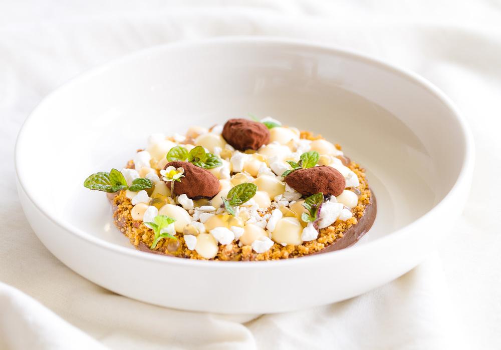 Chocolate-nut ganache, salted caramel creme, vanilla creme, caramelised nuts, coca coated almonds and caramel gel