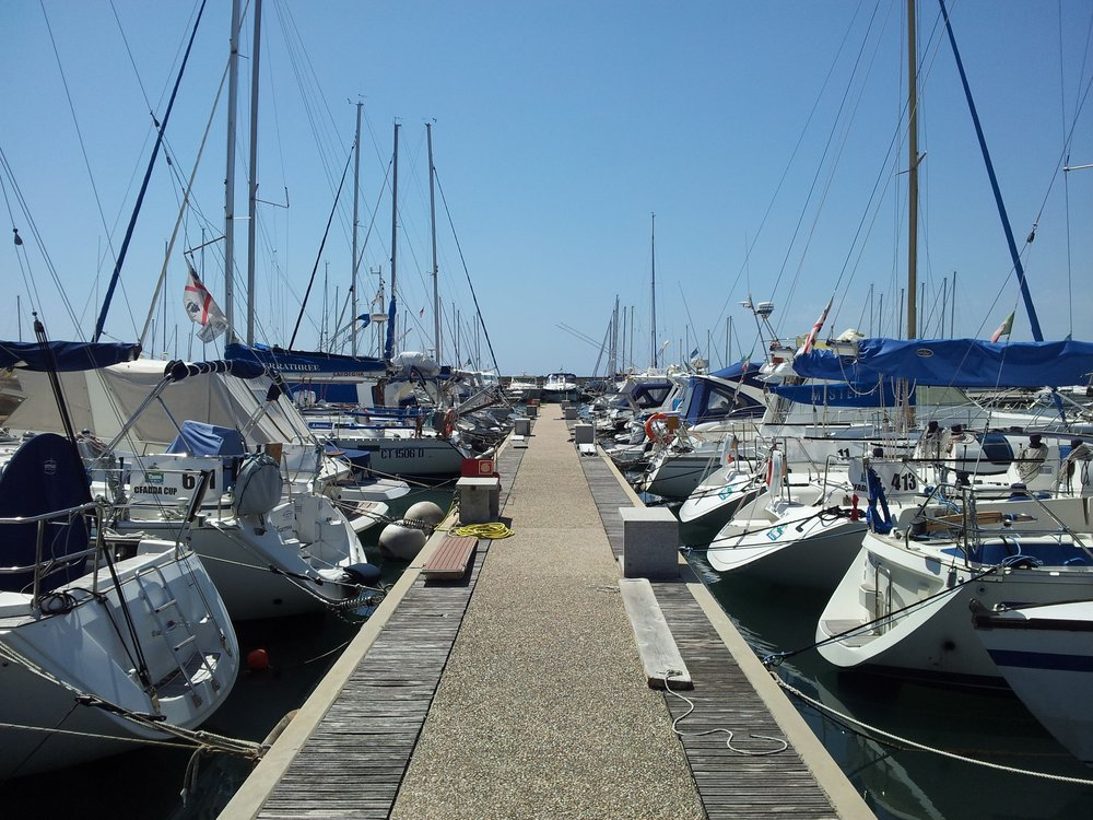 Sailboats on berth at Marina di Capitana
