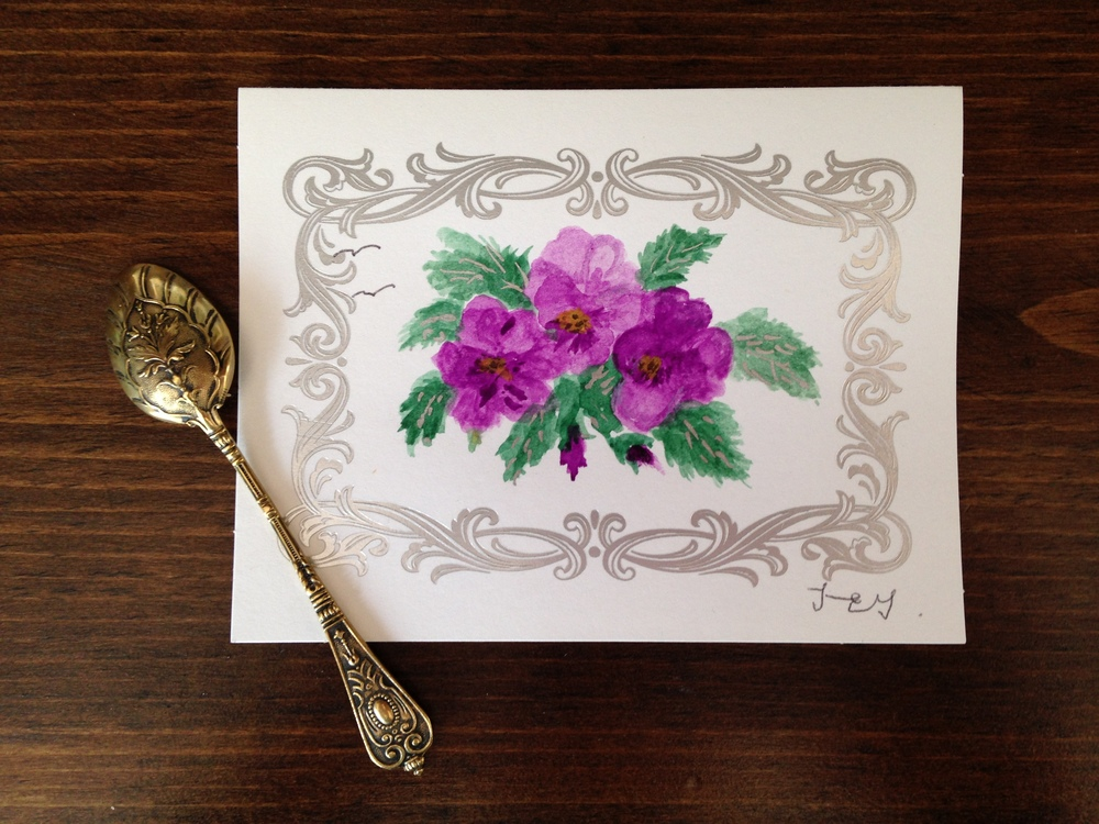 "Pictured here is the last birthday card she did for me, hand painted pansies. This little spoon was something she gave me a few years ago. She told me she saved this spoon from an old man's garbage can at the nursing home she worked at many, many moons ago. She was a thrifter before ""thrifting"" was even a thing."