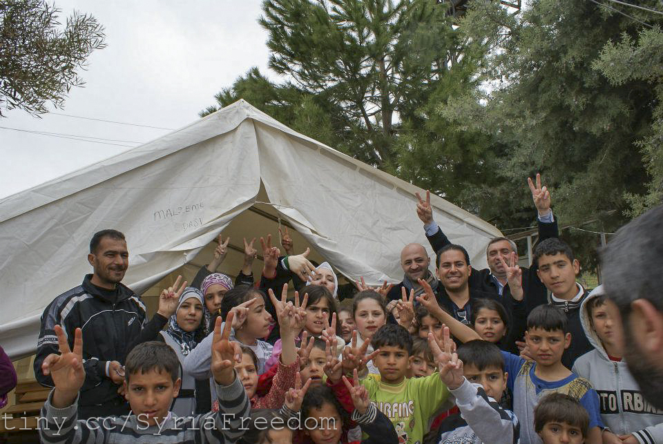 Syrian activists and Haytham al-Maleh trip to the Syrian refugee camps in Turkey.jpg