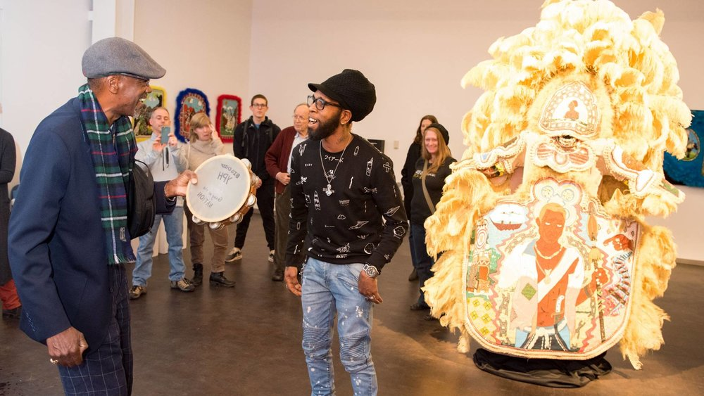 Big Chief Darryl Montana of the Yellow Pocahontas Hunters (left) and Big Chief Demond Melancon of the Young Seminole Hunters — two leaders of New Orleans' indigenous Black Indian groups — break into spontaneous song at an April 3 reception in the CoLab gallery space in the new Lewis Arts complex at Princeton University. The chiefs' visit to Princeton, in conjunction with an exhibition of the groups' elaborate ceremonial suits and other artwork, included a panel discussion and classroom visit. Photo by Adena Stevens