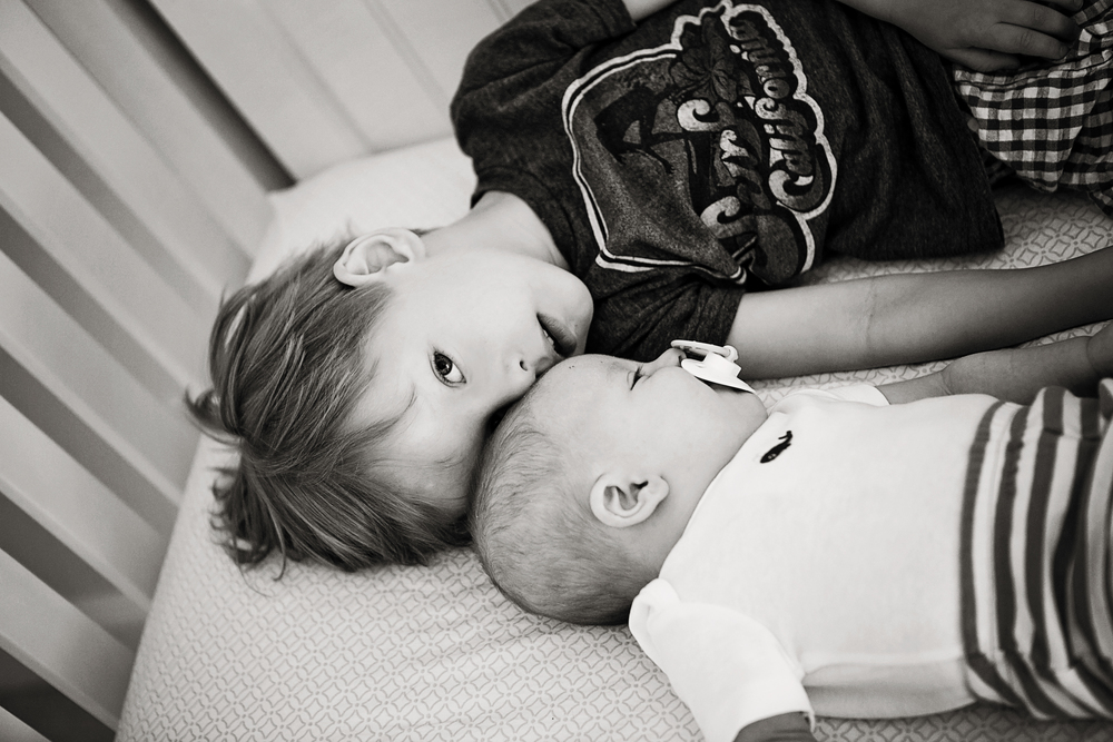 Garrison & Ford snuggling in the crib-8b&w.jpg
