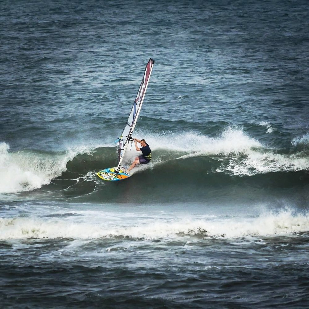 Brendan windsurfing in Cape Hatteras, 2017.