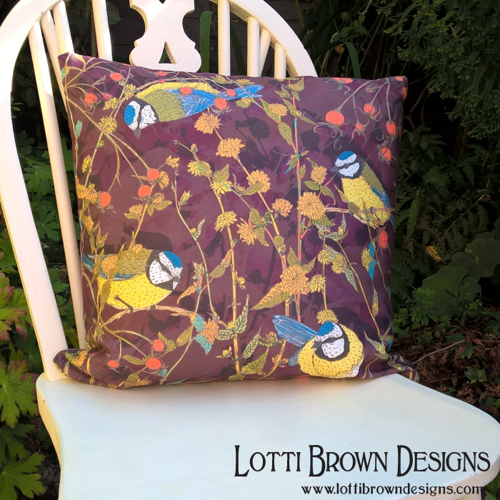 Bluetits cushion available from Lotti Brown at Redbubble