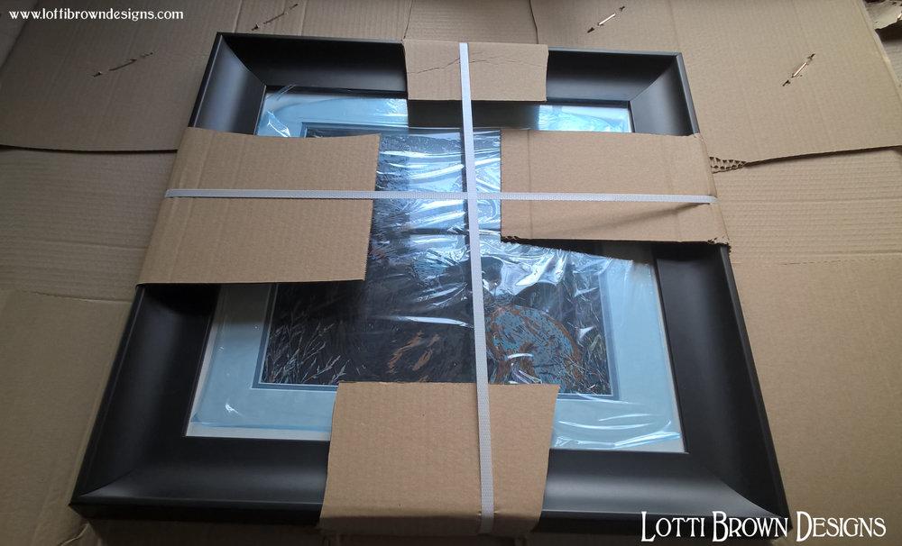 Strapped securely, the framed artwork should arrive safely.