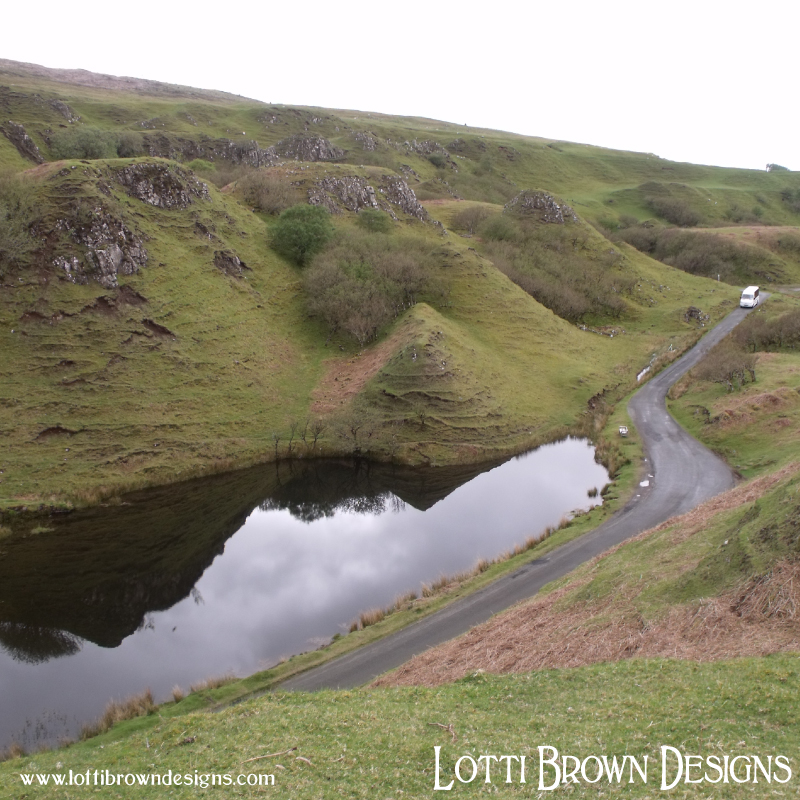 Pointy hills and dark lochans add to the atmospheric Fairy Glen