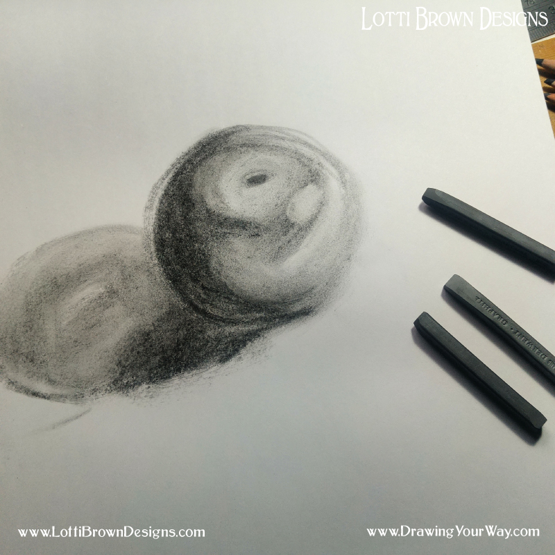 Exploring the shadows on a fruit with graphite sticks