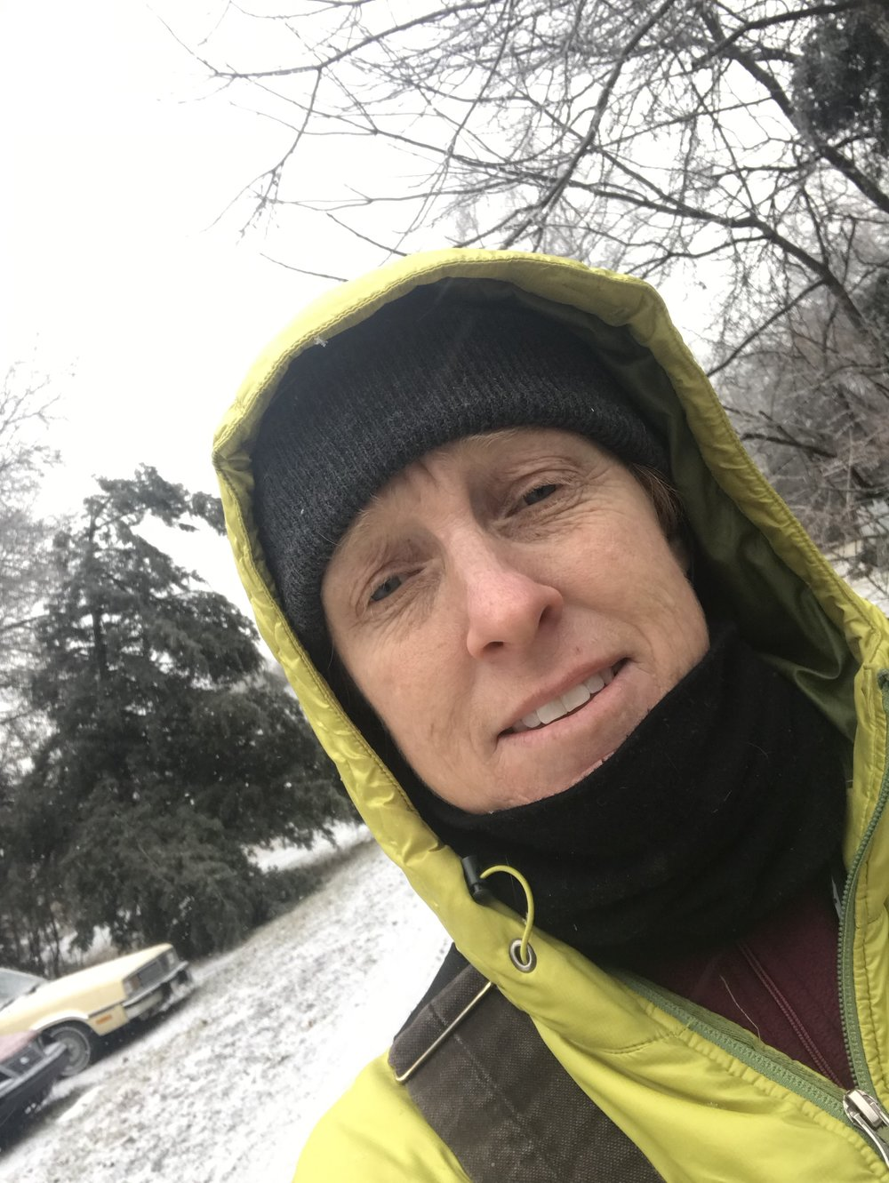 Maggie bundled up to do winter chores at her own farm, where she cares for three horses, one mule, three chickens, one dog, three cats and three humans.