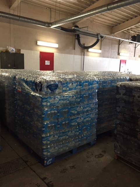 Warehouse holding palates of water for distribution at Fairhaven & Eternal Life Seventh-day Adventist Churches