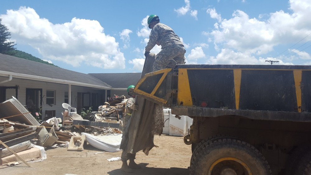 The Baptiste dump truck loaded by National Guardsmen around town