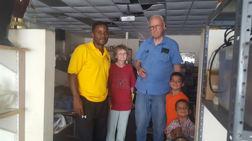 NAD ACS DR Director, W. Derrick Lea, with SDA owners in their thrift store