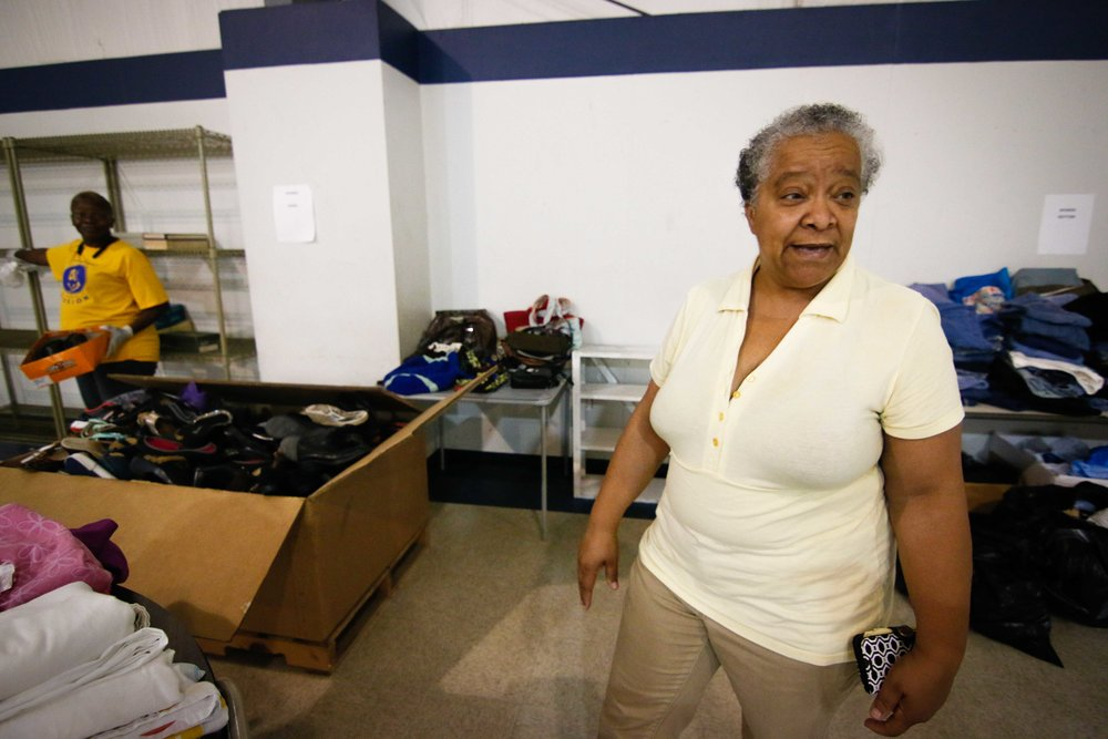 The Berean Seventh-day Adventist Church distribution center is managed by Lyn Hakeem (right), director of the church's wellness center.  Photo by Stephen Ruf.