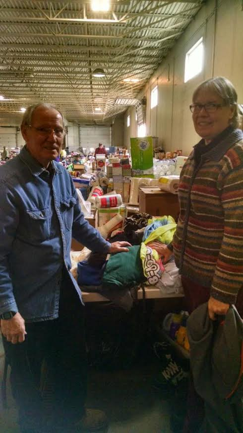 Volunteers, Dave and Colleen Schultz, helping out at the Donation Center.