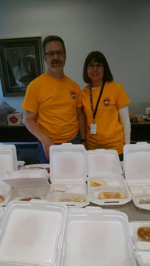Mark and Kelly Graham working with Salvation Army to make meals for the volunteers and survivors at the Multi-Agency Resource Center. They served over 500 meals on Sunday.