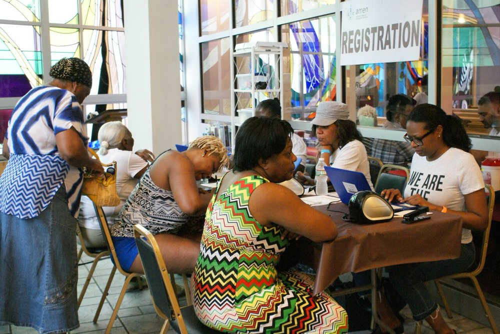 Patients registering for the AMEN clinic. Photo by Kenneth Moore, Jr.