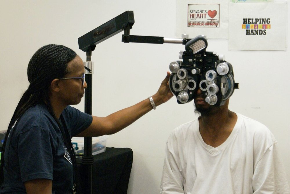 Dr. Gayle Daniels giving a vision exam. Photo by Kenneth Moore, Jr.