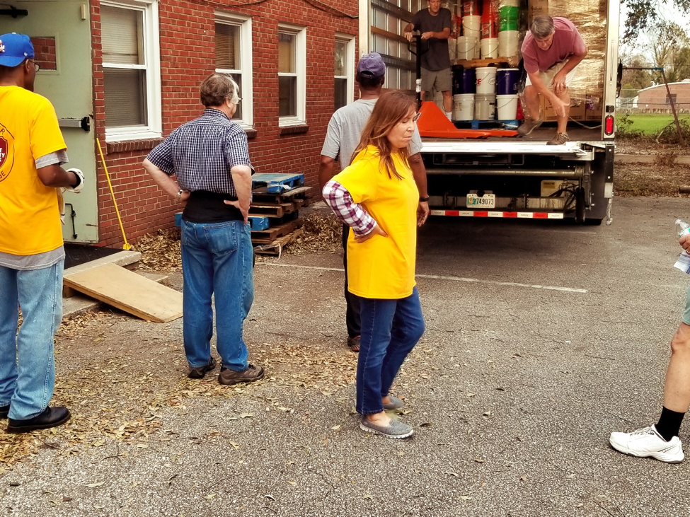 ACS volunteers unloading the truck filled with donated goods.