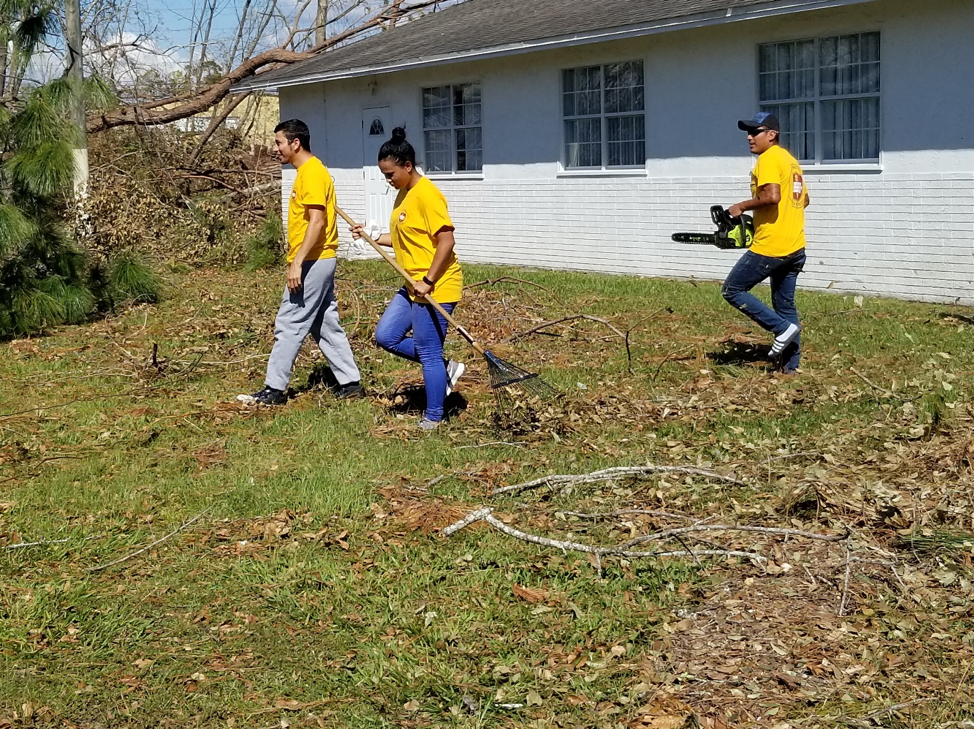 ACS DR Team work to clear debris from Maranatha SDA Church for Distribution site for the community.