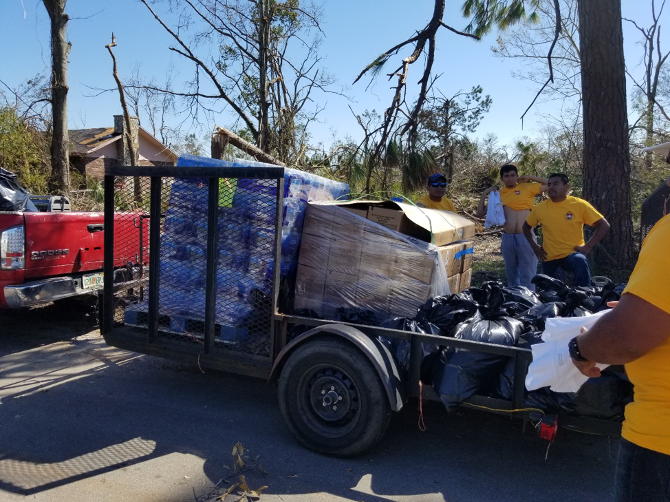 Loading up food and water for the affected community in Panama City.