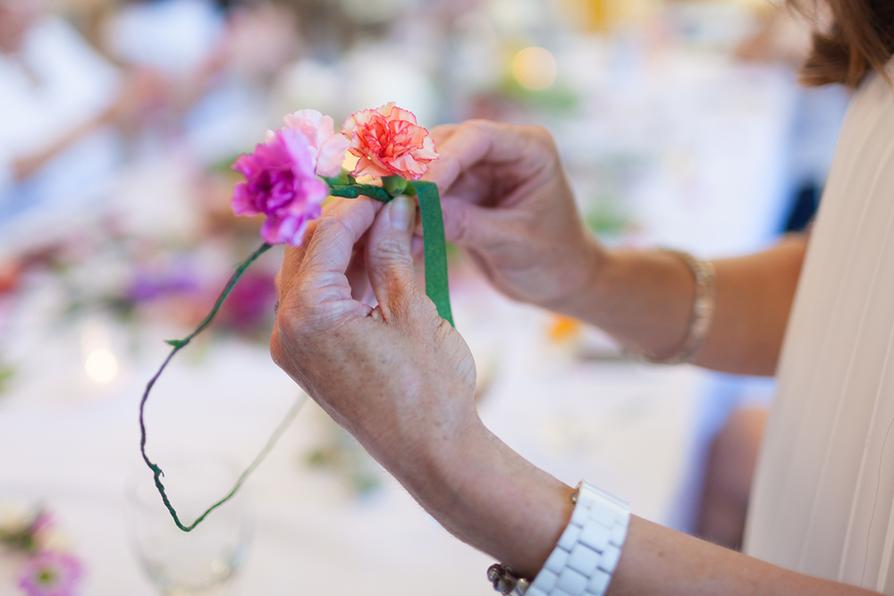 Flower crafts at an evening event.