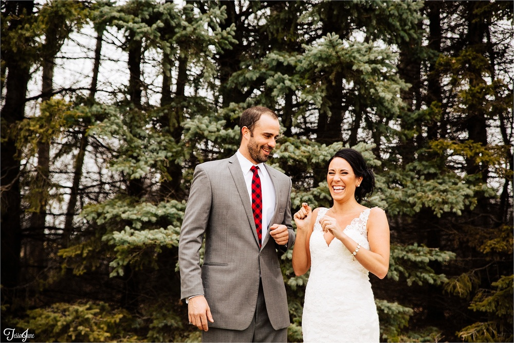 st-cloud-minnesota-wedding-photography-hamburg-winter-buffalo-plaid-rustic-bride-groom-laugh-woods