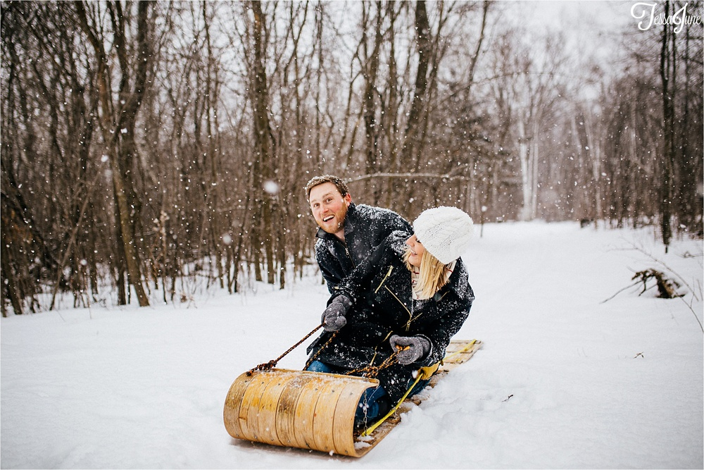 st-cloud-minnesota-winter-engagement-snow-cabin-woods-wedding-sledding