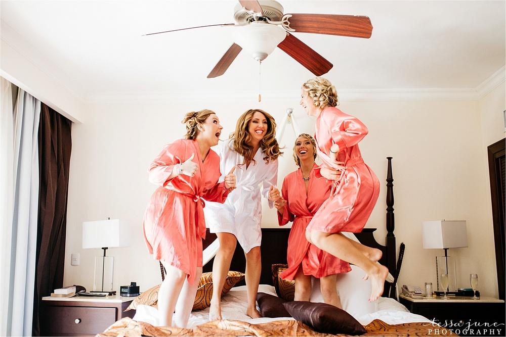 punta-cana-destination-wedding-dreams-palm-beach-resort-bridesmaids-jumping-on-bed