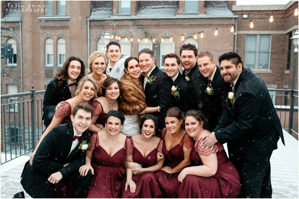 912-regency-plaza-wedding-st-cloud-winter-decemeber-bridal-party-wine-bridesmaids-snowing