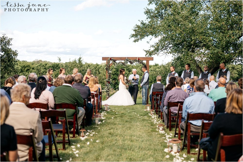 st-cloud-minnesota-wedding-photographer-outdoor-wedding-with-farm-tables-and-gorgeous-floral-from-artemisia-studios-29.jpg