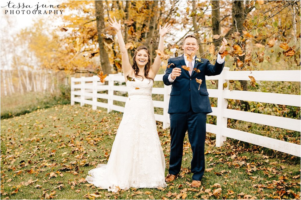 birch-hill-barn-october-wedding-wisconsin-throwing-leaves