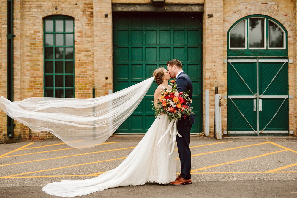 Nicollet-Island-Pavilion-Minneapolis-September-Coral-Navy-Wedding-58.jpg