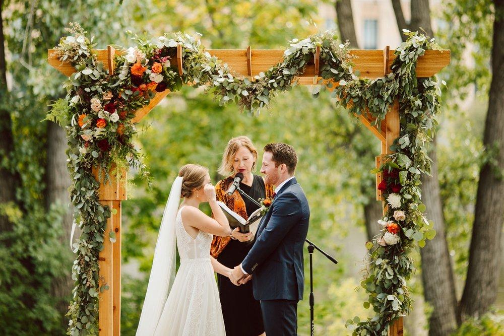Nicollet-Island-Pavilion-Minneapolis-September-Coral-Navy-Wedding-109.jpg