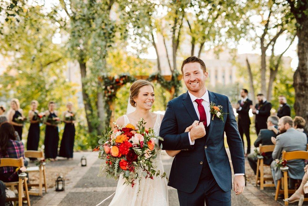 Nicollet-Island-Pavilion-Minneapolis-September-Coral-Navy-Wedding-119.jpg