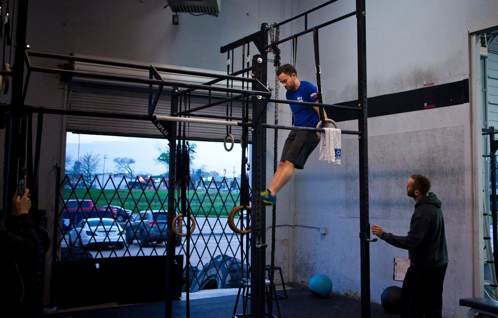 Jeff doing Muscle Ups during the Open Wod 15.3