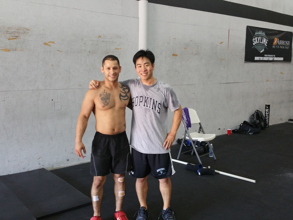 Martin  Perelta and Skyline Weightlifting coach Brad Kim.  Martin is Skylines first athlete to qualify for the American Weightlifting Open in Reno, Nevada.  Martin snatched 206lbs and Clean and Jerked 265lbs at 148lbs body weight.