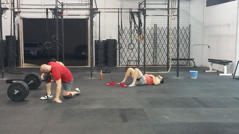 Brian, Chris, and Mike giving thanks to the CrossFit Gods.