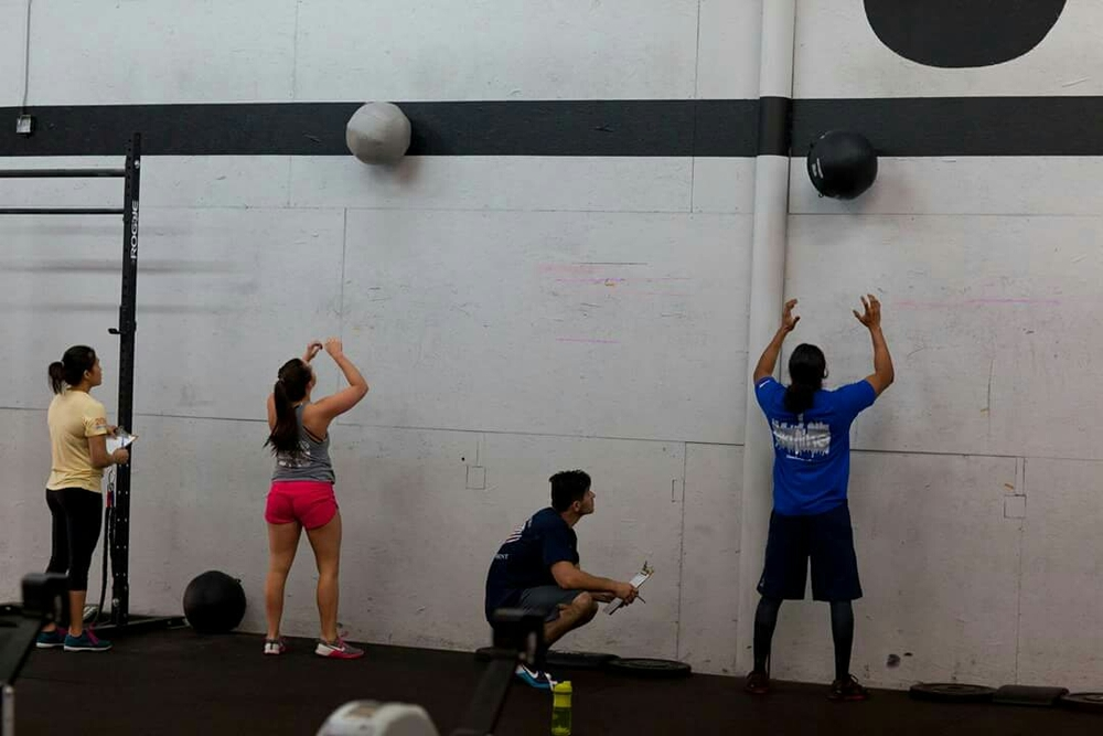 Alicia and Alex going head to head on wallballs.