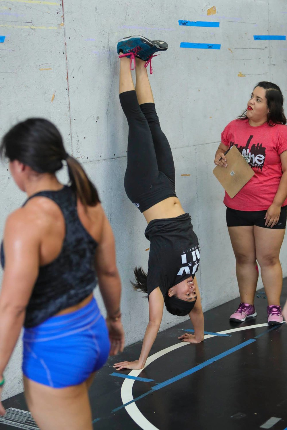 Coach Terri showing a good lockout in the handstand pushup.