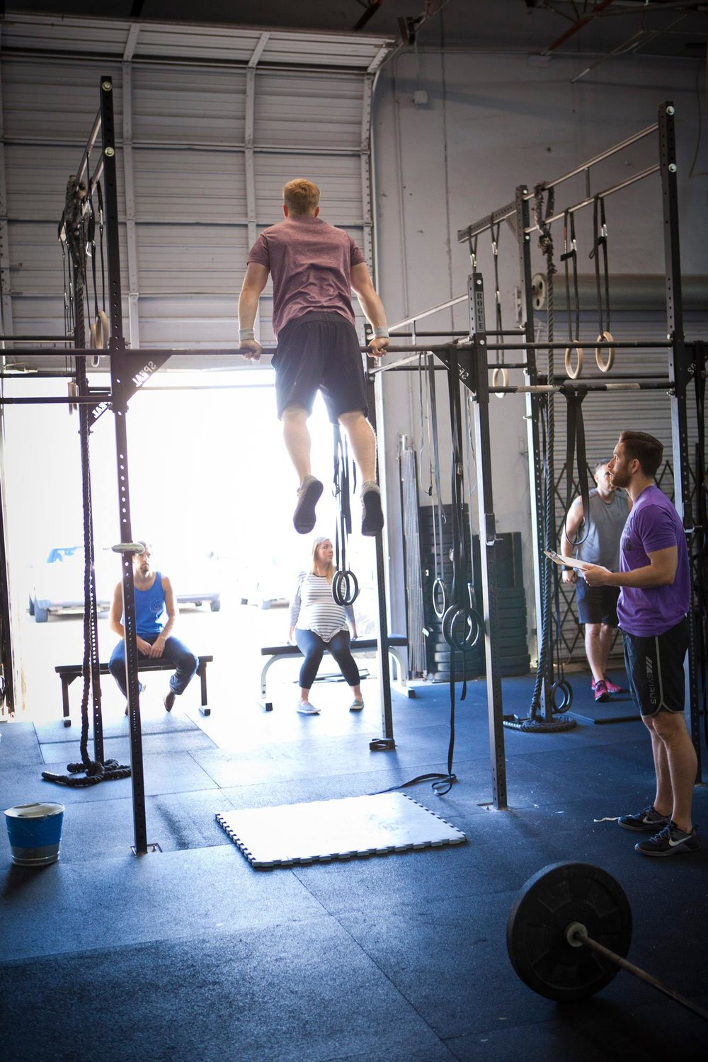 Brad completing Bar Muscle Ups during CrossFit Games Open 16.3